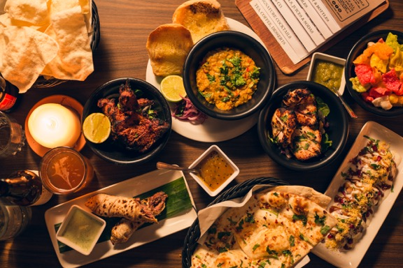 A table laden with dishes from Mughli - one of the first Indian restaurants in Manchester to embrace street food.