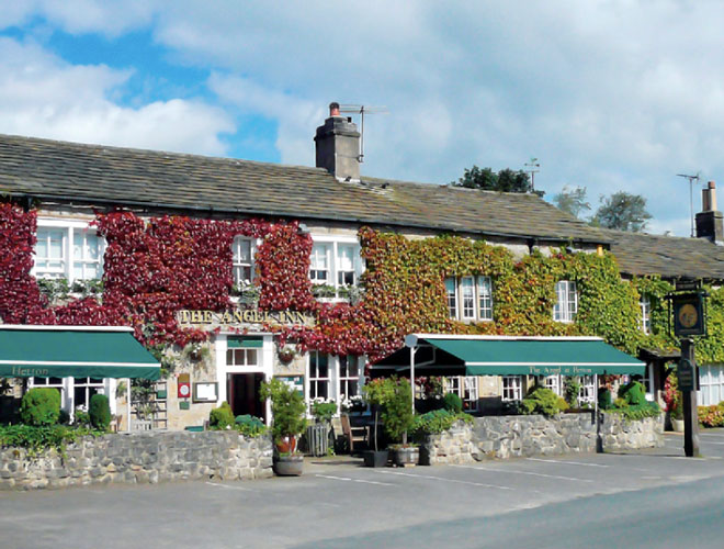 The ivy-clad exterior of The Angel at Hetton - a Michelin star restaurant in the Yorkshire Dales