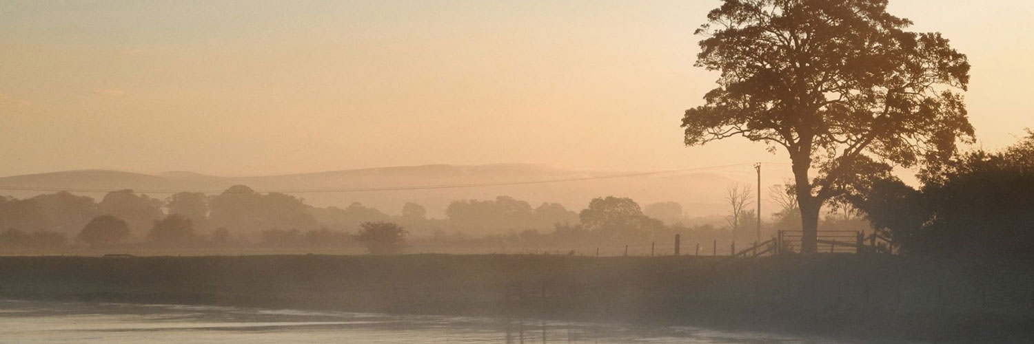 A misty view of the Lancashire countryside from The Cartford Inn - a restaurant and hotel near Preston