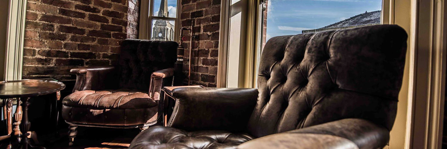 A leather armchair inside The Clarence - a Confidential Guides recommended pub in Bury, Greater Manchester
