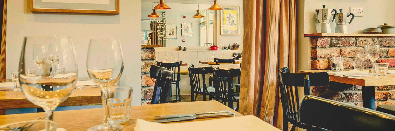 Tables set ready for dinner at Joseph Benjamin restaurant in Chester.