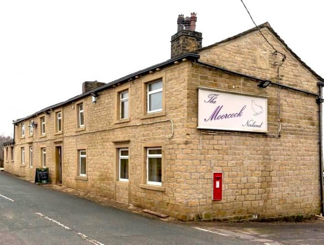 The unassuming exterior of The Moorcock Inn in Sowerby Bridge: a Confidential Guides recommended restaurant