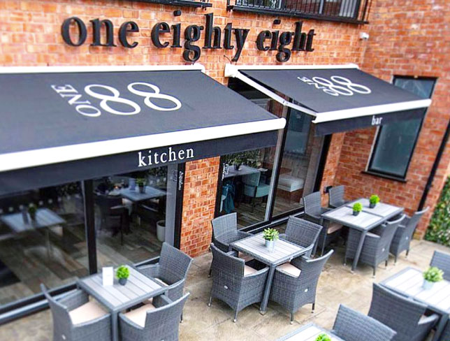 Outdoor terrace seating at One 88 Kitchen & Bar in Whitefield, owned by chef-patron David Gale.