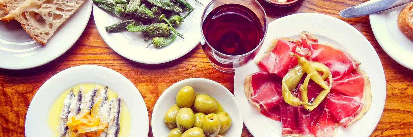 A table laded with tapas dishes at Porta Altrincham - a Spanish restaurant recommended by Confidential Guides
