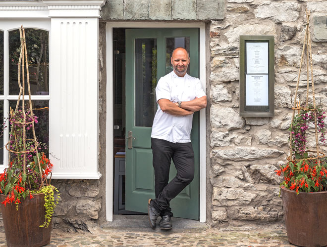 Simon Rogan outside his neighbourhood restaurant Rogan & Co. in Cartmel, Cumbria