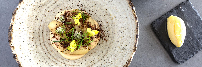 Fresh flowers adorn a dish at Rogan & Co. - a Michelin star restaurant in Cartmel, Cumbria