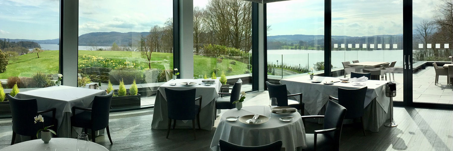 Inside The Samling's glass-fronted dining room with views of Lake Windermere