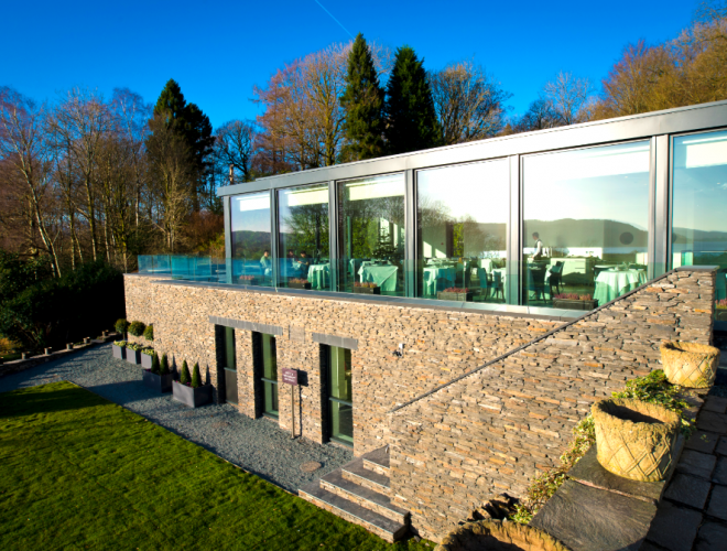 The glass-fronted dining room at The Samling has views of Lake Windermere