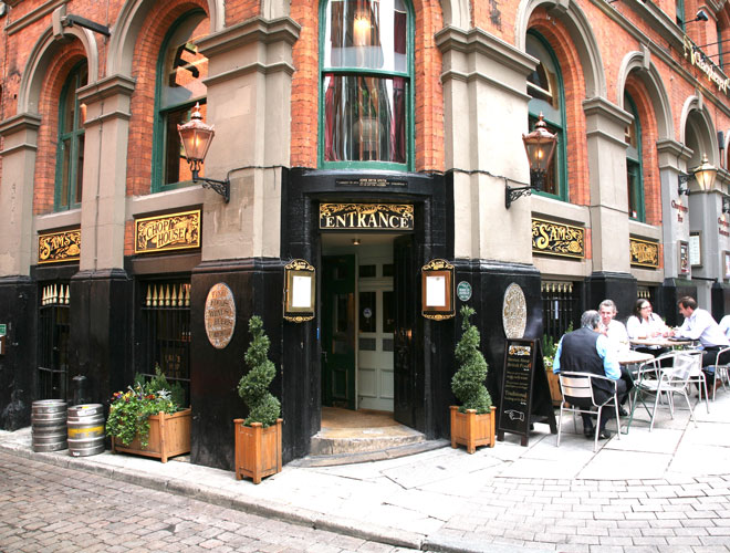 The exterior of Sam's Chop House - a Victorian-style British pub and restaurant in Manchester city centre