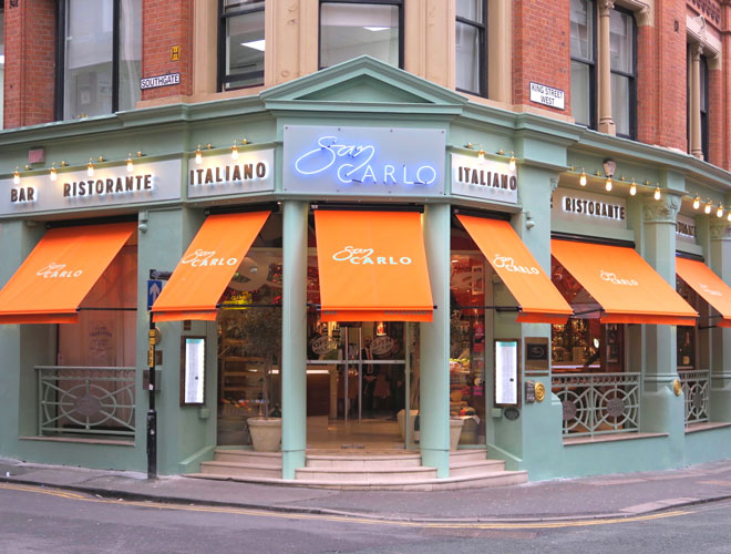 The exterior of San Carlo Manchester with its distinctive orange awning.