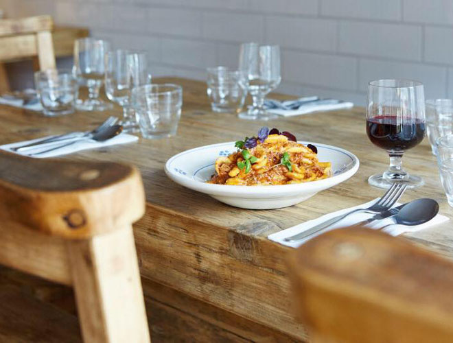A dish of pasta with a glass of red wine at Sugo Pasta Kitchen Altrincham, a Confidential Guides recommended restaurant