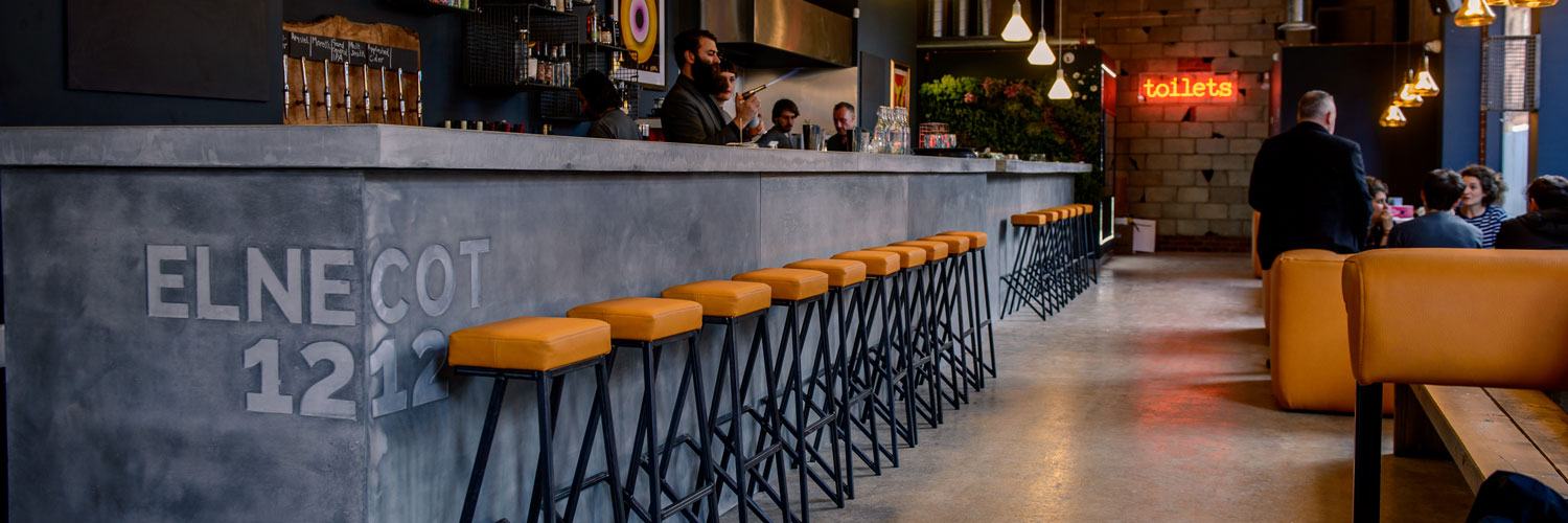 Take a seat at the bar at Elnecot for inventive cocktails and local craft ales.