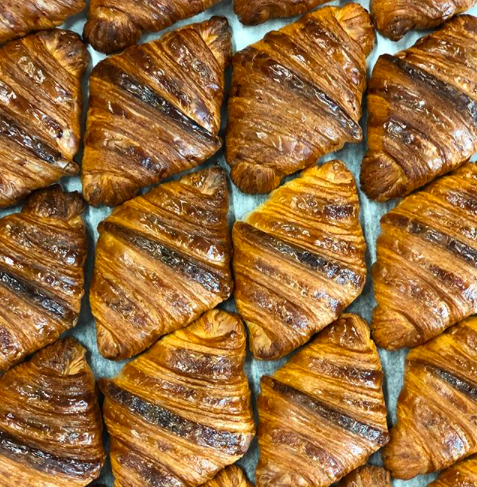 Croissants fresh from the oven at Pollen Bakery - an award-winning bakery and cafe in New Islington, Manchester