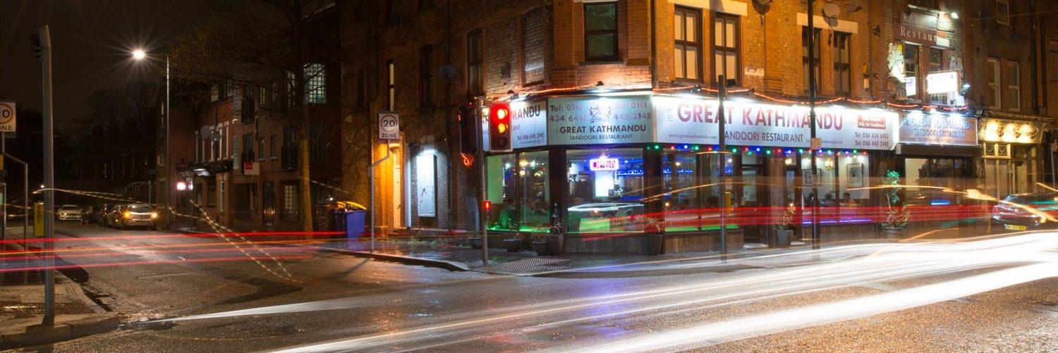 The exterior of The Great Kathmandu restaurant in West Didsbury, lit up at night