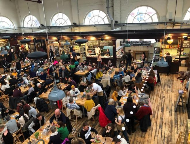 Inside the bustling Market House Indoor Food Hall in Altrincham, Greater Manchester.