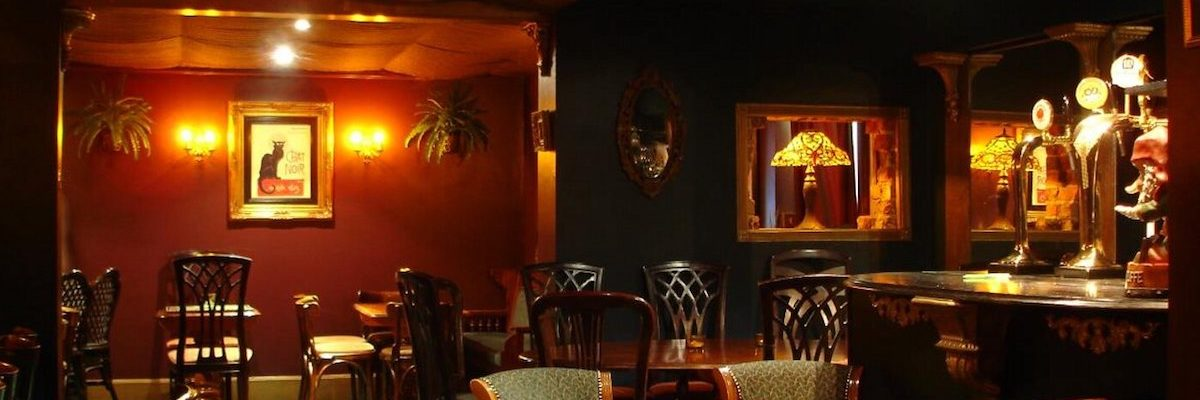 The dark, underground interior of atmospheric bar Mort Subite in Altrincham.