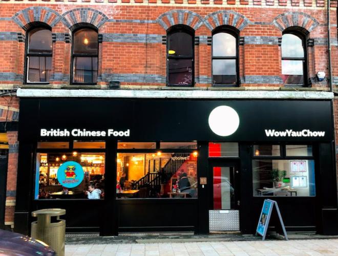 The striking black exterior of WowYauChow - a modern British Chinese restaurant in Altrincham
