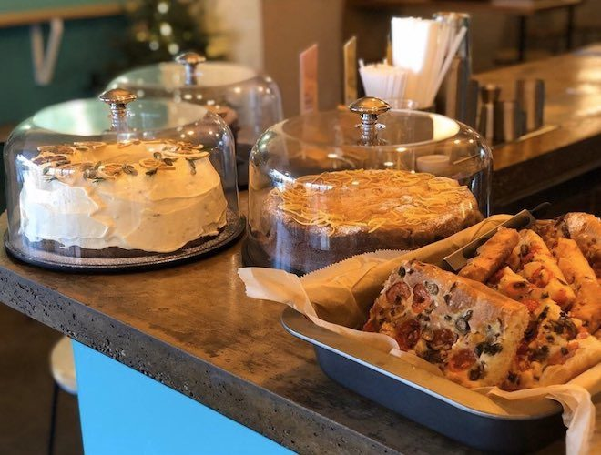 Cakes on display on the counter at Nordie Bar in Levenshulme.