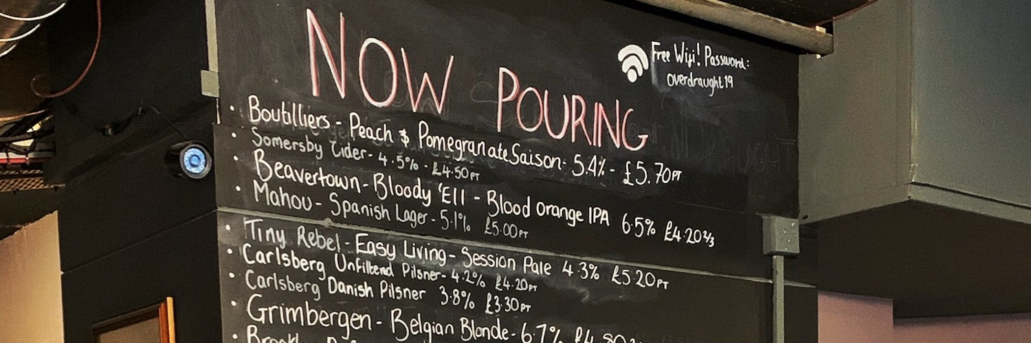A rotating menu of craft ales and lagers at Overdraught MCR in Levenshulme, Manchester.