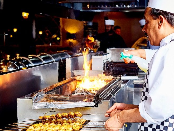 A chef cooking at Royal Nawaab - the three-storey restaurant in Levenshulme, Manchester.
