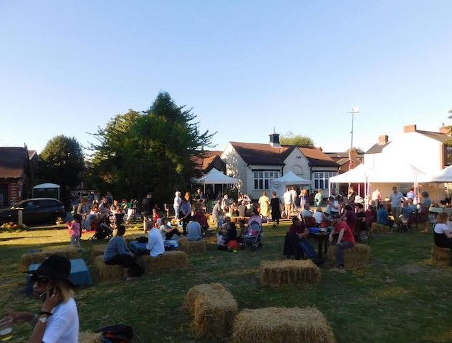 Guests enjoying a sunny evening in Levenshulme at The Klondyke Club social club