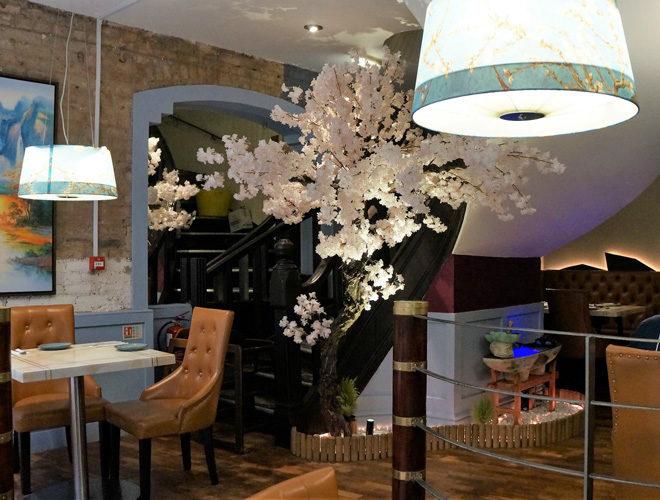 Interior seating and blossom tree at Annyeong Manchester