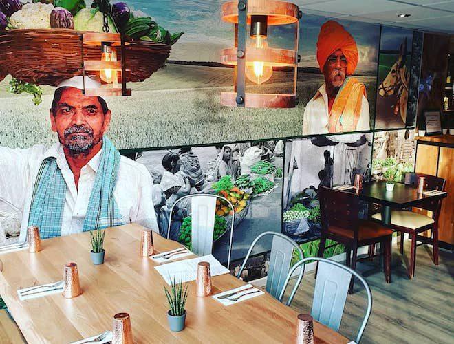 Mural and seating at Bhaji Pala Restaurant Gatley Manchester