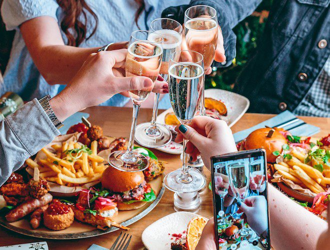burger fries and prosecco at Banyan manchester Corm Exchange