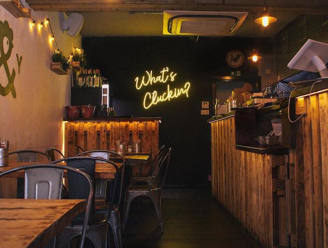 What's Cluckin' neon sign at Peck & Yard, Great Ancoats Street, Manchester