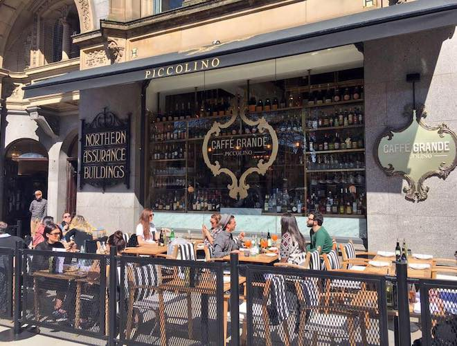 The outdoor dining space to Piccolino Restaurant overlook Albert Square in Manchester