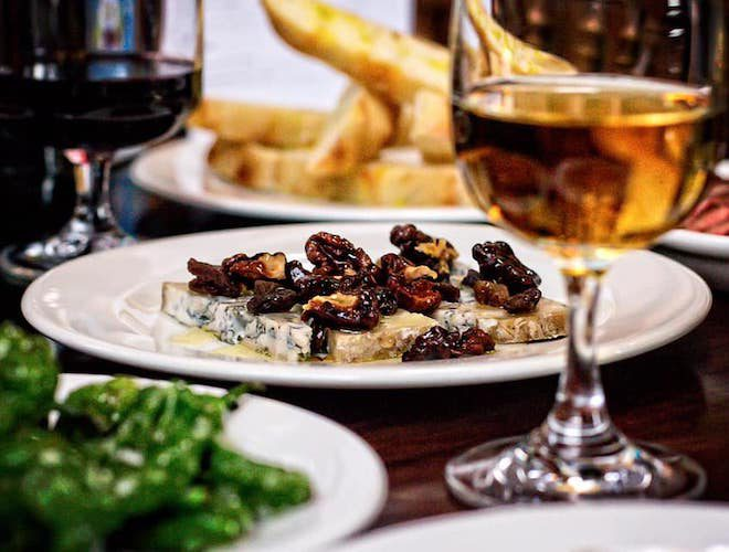 Blue cheese and walnuts with a glass of wine, padron peppers at Porta Salford