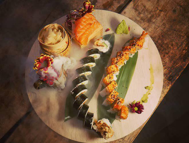 chefs omakase platter of salmon sashimi, uramaki and nigiri