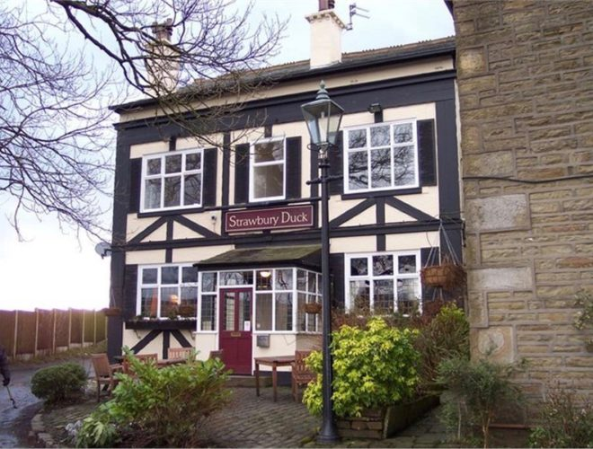 Exterior of the Strawbury Duck, a traditional country pub with rooms in Entwistle, Bolton