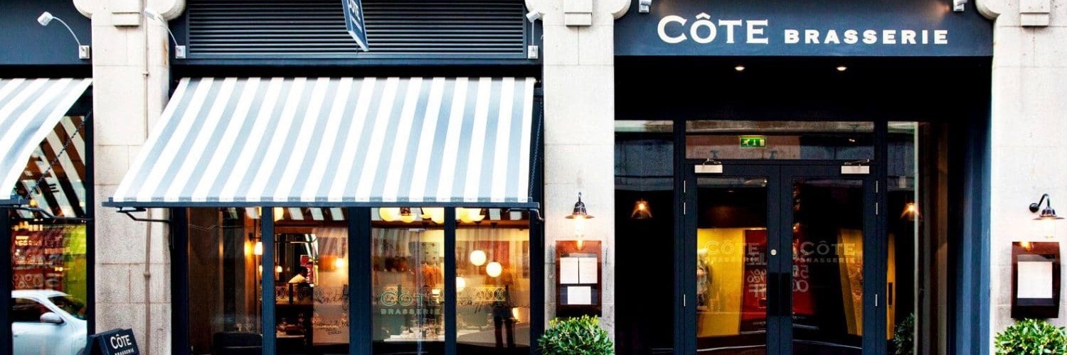 Exterior of Cote Brasserie, a French restaurant in Manchester city centre