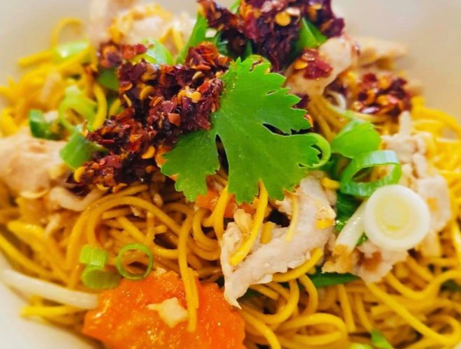 A Thai noodle dish with fresh herbs at Jarern Street Food in Bolton