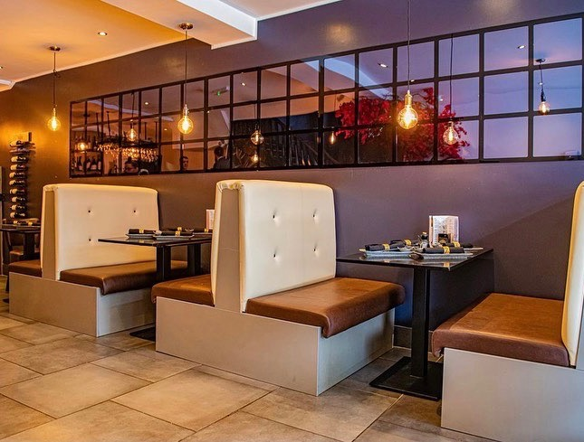 The interior of Kampai Sushi, a Japanese restaurant in Hale, Greater Manchester.