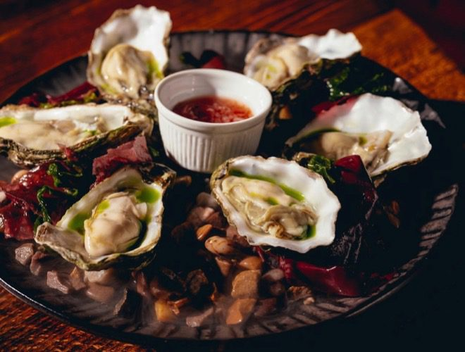 Oysters as served at Rendition, a Modern British restaurant and bar on Deansgate in Manchester city centre.