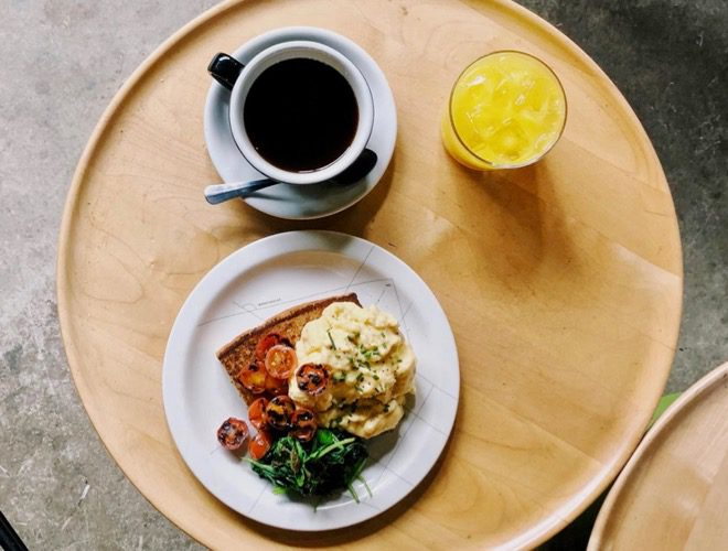 Brunch served at Foundation Coffee House Northern Quarter, a coffee shop in the restored Sevendale House on Lever Street, Manchester.
