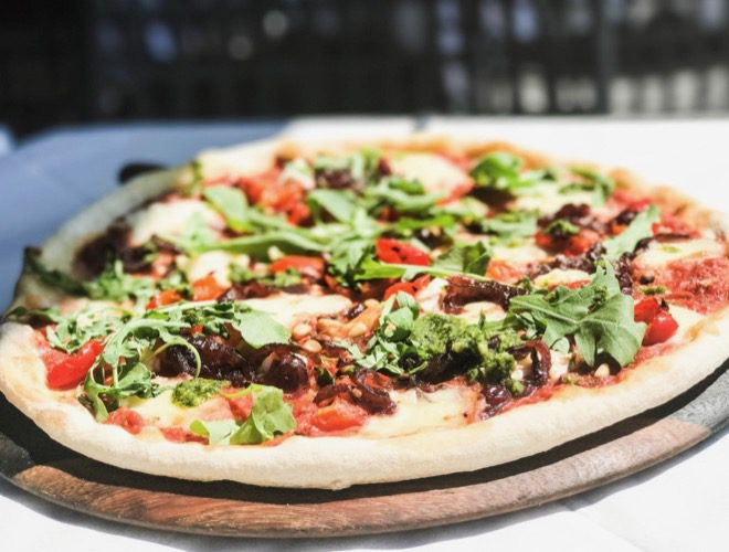 One of the pizzas served on the terrace at Gusto Heswall, a recommended Italian restaurant.