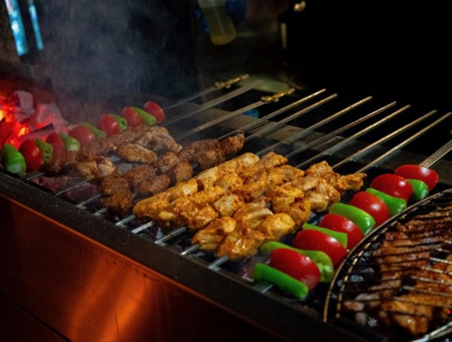 Kebabs lined up on the barbecue at Gustum, a Turkish restaurant in Liverpool.