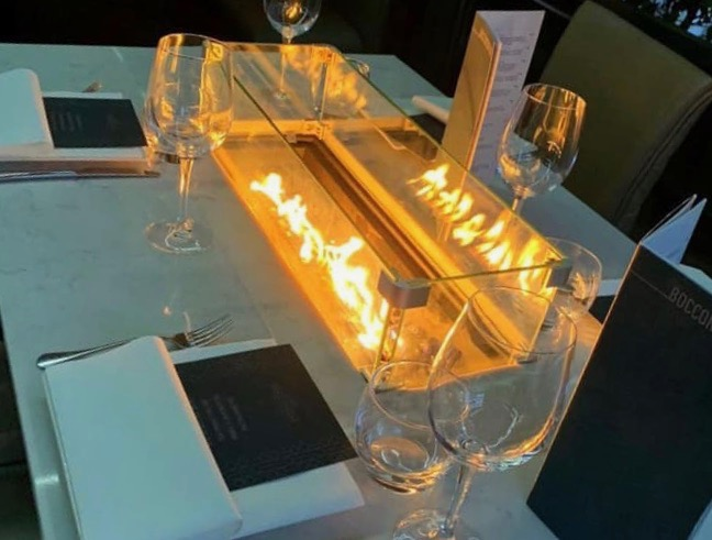 One of the fire pit tables on the terrace at Il Forno - an Italian restaurant and bar in Liverpool.