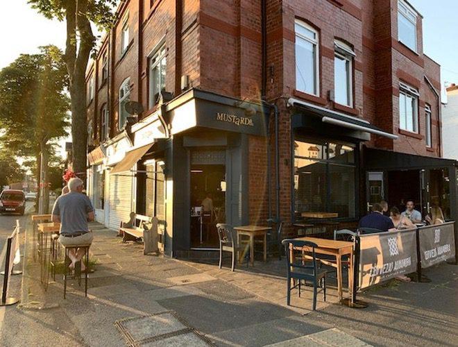 The exterior of Mustard & Co, a neighbourhood bistro in Crosby, Merseyside.
